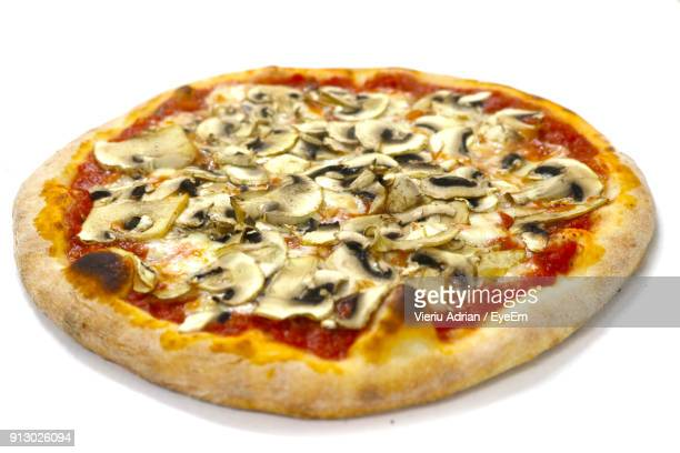 Close-Up Of Pizza Over White Background