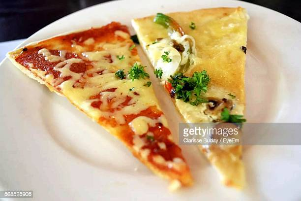 Close-Up Of Pizza Slices Served On Plate