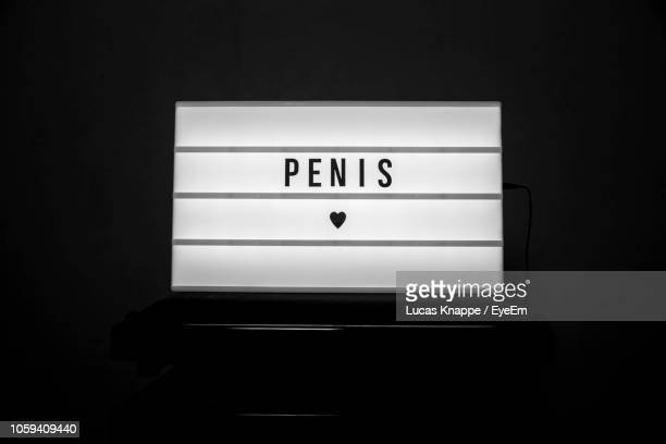 close-up of placard with penis text over black background - foreskin stock pictures, royalty-free photos & images