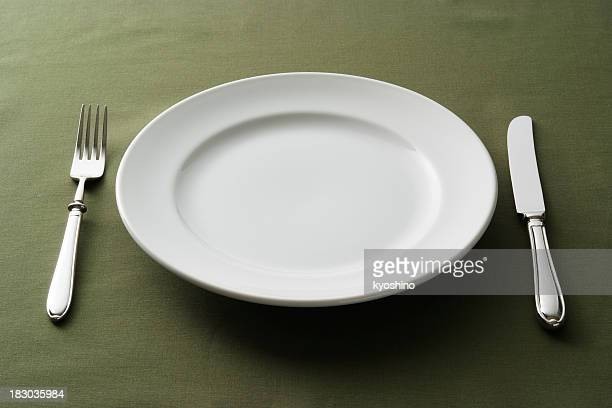 Close-up of place setting on green tablecloth
