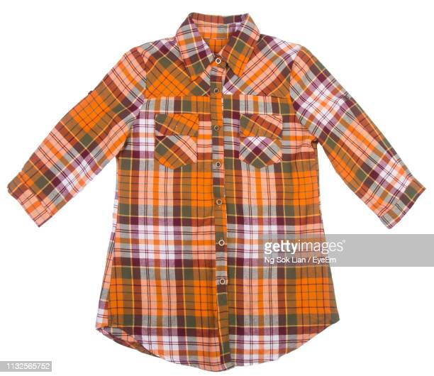 close-up of plaid shirt against white background - printed sleeve stock pictures, royalty-free photos & images