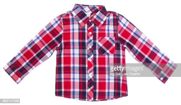 close-up of plaid shirt against white background - shirt stock pictures, royalty-free photos & images