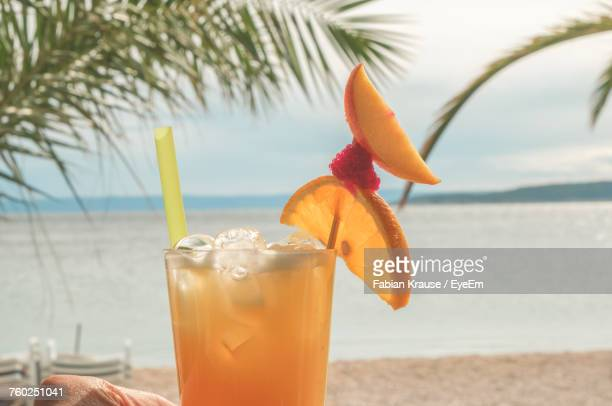 Close-Up Of Planters Punch Cocktail On Beach