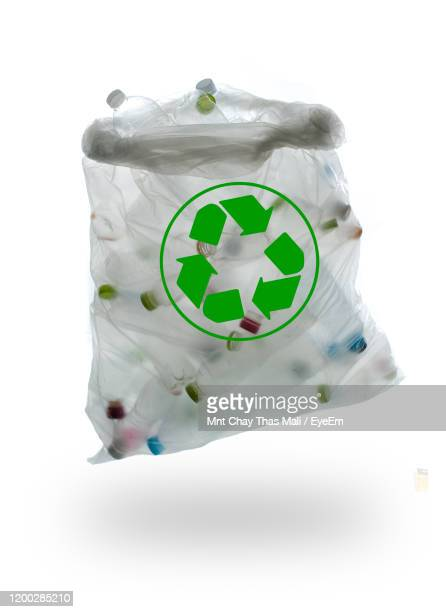 close-up of plastic bag with empty bottles over white background - ゴミ袋 ストックフォトと画像