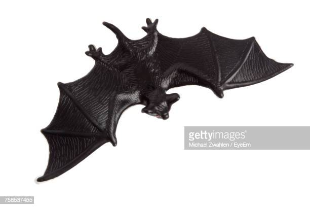 Close-Up Of Plastic Bat Over White Background