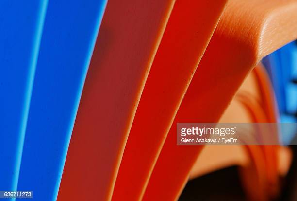 Close-Up Of Plastic Chairs Stack
