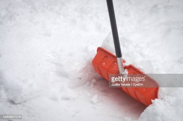 close-up of plastic equipment on snow - shovel stock pictures, royalty-free photos & images
