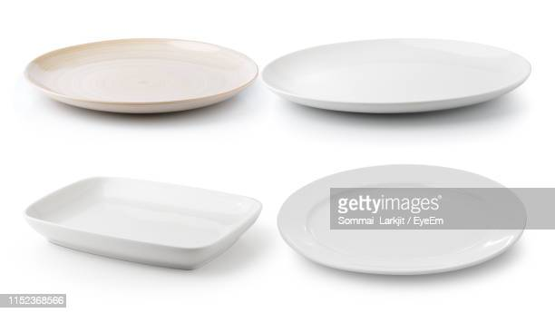 close-up of plates over white background - prato - fotografias e filmes do acervo