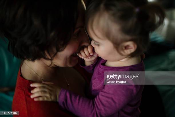 close-up of playful mother playing with daughter at home - daughters of darkness stock pictures, royalty-free photos & images