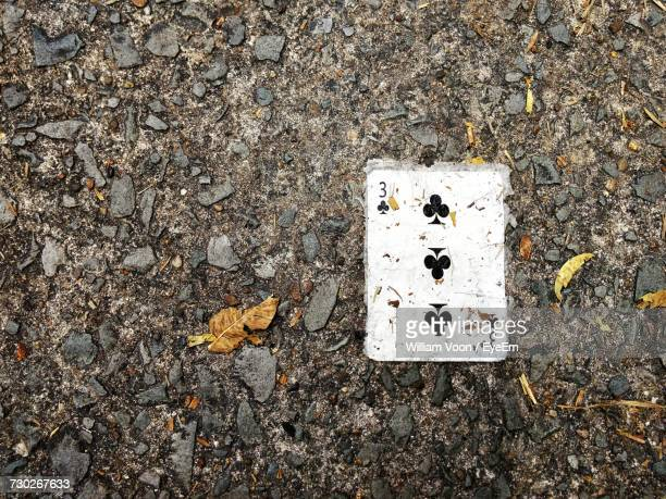 Close-Up Of Playing Card On Ground