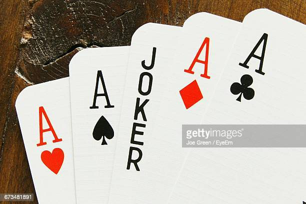 close-up of playing cards - joker card stock photos and pictures
