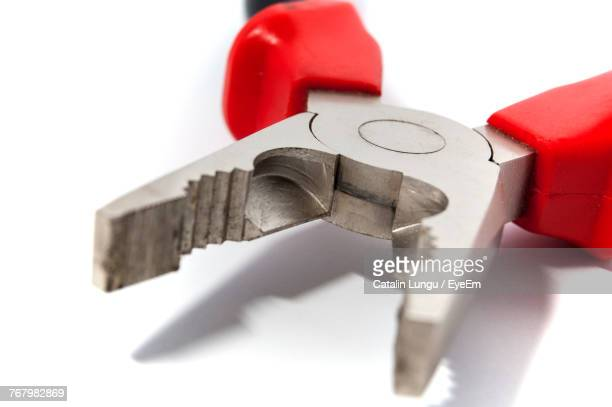 Close-Up Of Pliers On White Background