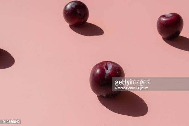 close-up of plums on table - plum stock pictures, royalty-free photos & images