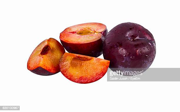 Close-Up Of Plums Over White Background