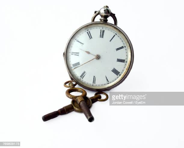 Close-Up Of Pocket Watch Against White Background