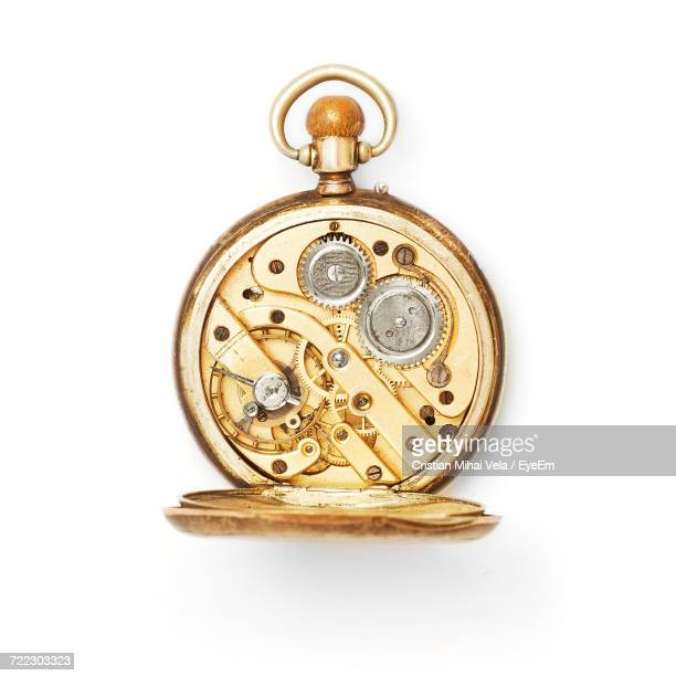 Close-Up Of Pocket Watch On White Background