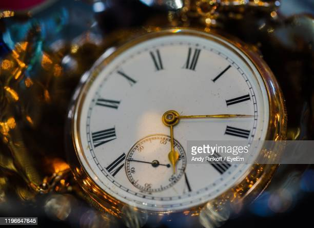 close-up of pocket watch - andy rinkoff stock pictures, royalty-free photos & images