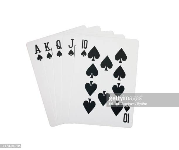 close-up of poker cards on white background - poker stock-fotos und bilder
