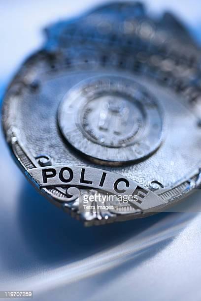 Close-up of police badge, studio shot