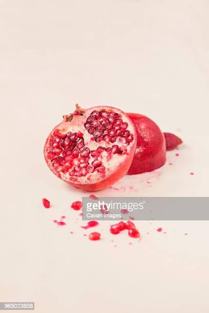 close-up of pomegranate on white background - granada fotografías e imágenes de stock