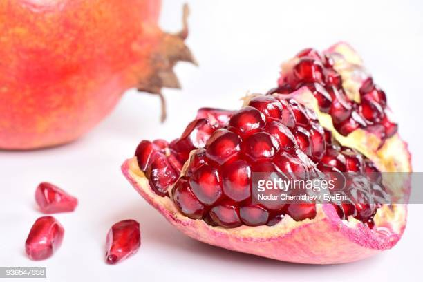 Close-Up Of Pomegranate Over White Background