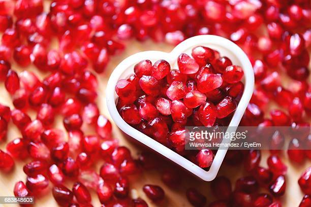 Close-Up Of Pomegranate Seeds In Heart Shape Container