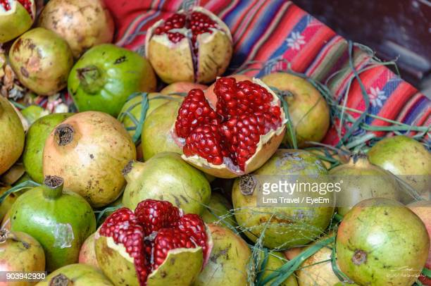 close-up of pomegranates in market - cochabamba stock pictures, royalty-free photos & images