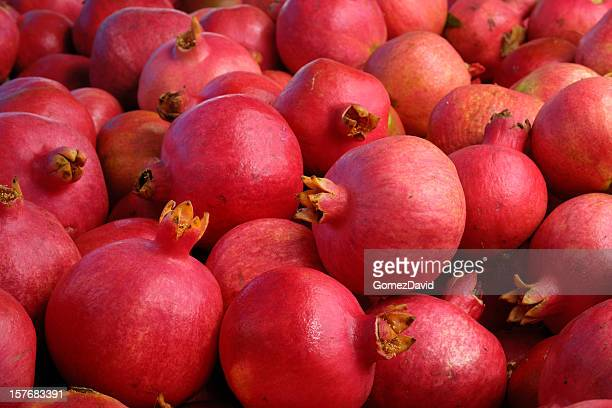 close-up of pomegranates packed in shipping crate - pomegranate stock pictures, royalty-free photos & images