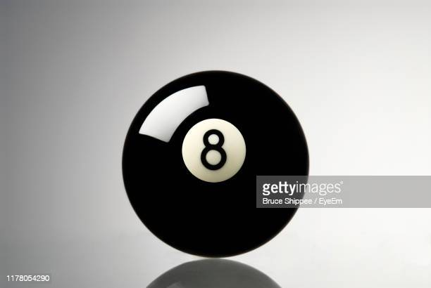 close-up of pool ball over gray background - number 8 stock pictures, royalty-free photos & images