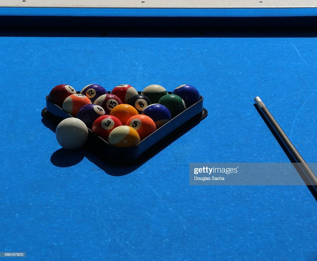 Close-Up Of Pool Balls By Cue On a outdoor blue Billiard Table : Stock Photo