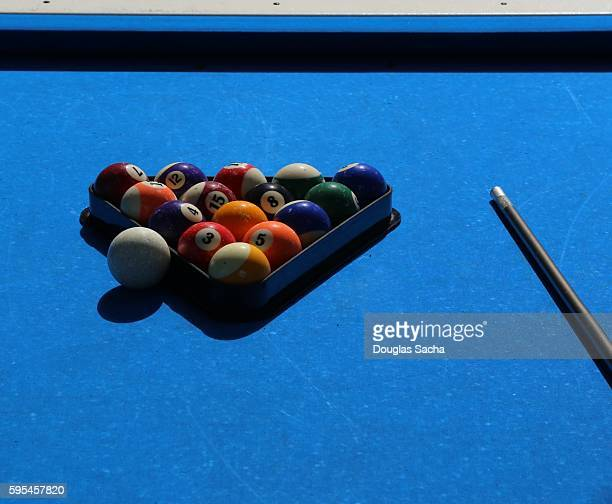 Close-Up Of Pool Balls By Cue On a outdoor blue Billiard Table