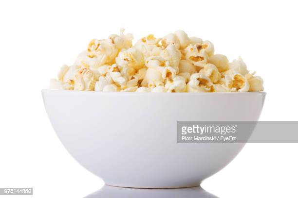 close-up of popcorn in bowl against white background - bowl stock pictures, royalty-free photos & images