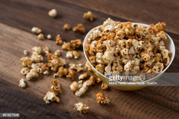 Close-Up Of Popcorns In Bowl On Wooden Table
