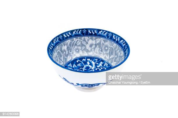 Close-Up Of Porcelain Bowl Over White Background