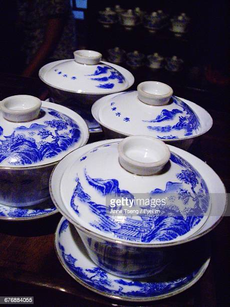 Close-Up Of Porcelain Casserole Dishes On Table