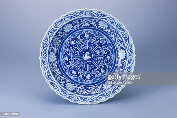 close-up of porcelain plate against gray background - porcelain stock pictures, royalty-free photos & images