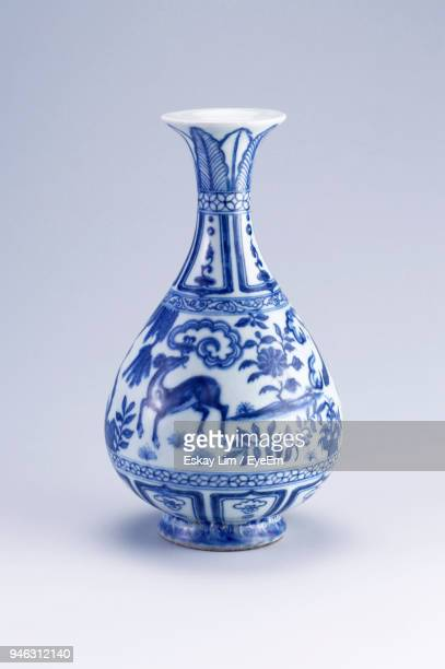 close-up of porcelain vase against white background - 骨董品 ストックフォトと画像
