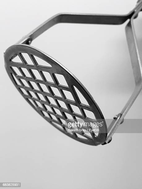 Close-Up Of Potato Masher On White Background
