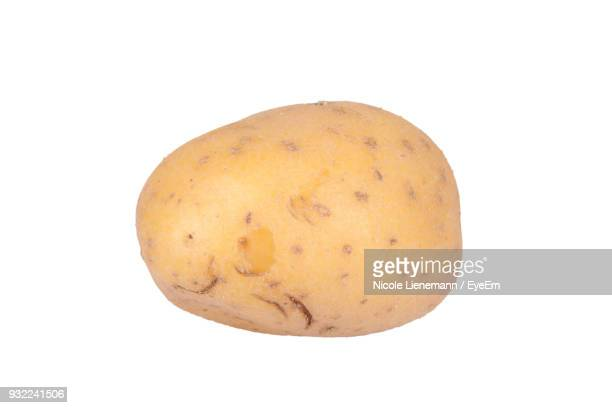 close-up of potato over white background - raw potato stock pictures, royalty-free photos & images