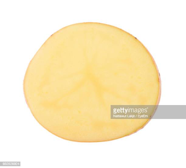 Close-Up Of Potato Slice Against White Background