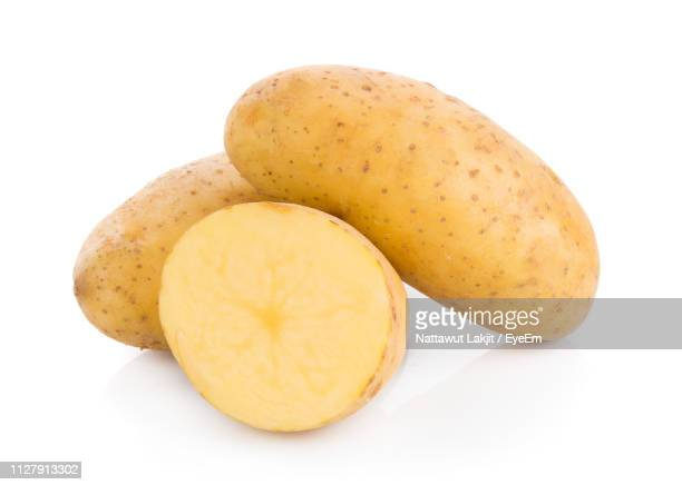 close-up of potatoes against white background - prepared potato stock pictures, royalty-free photos & images