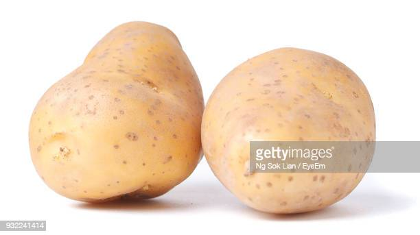 Close-Up Of Potatoes Against White Background