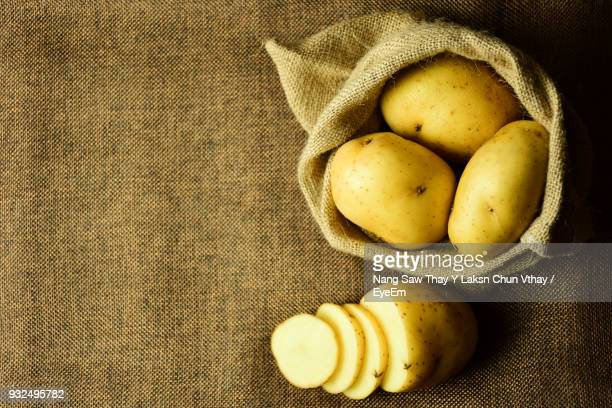 close-up of potatoes on burlap - prepared potato stock pictures, royalty-free photos & images