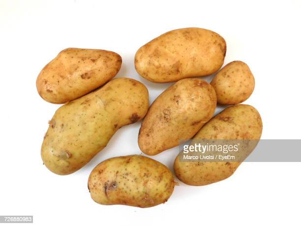 close-up of potatoes over white background - raw potato stock pictures, royalty-free photos & images