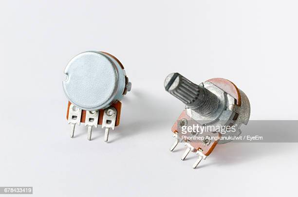 Close-Up Of Potentiometers On White Background