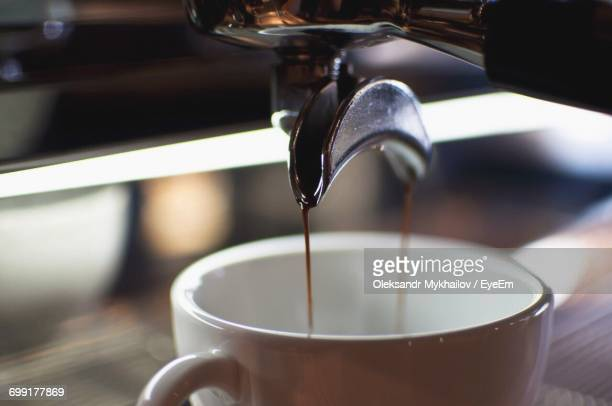 Close-Up Of Pouring Coffee In Glass