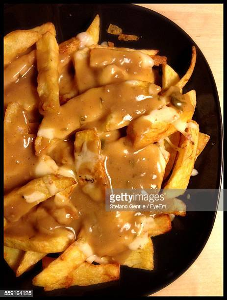 Close-Up Of Poutine Served On Table