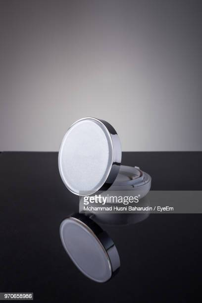 close-up of powder compact on table - powder compact stock pictures, royalty-free photos & images