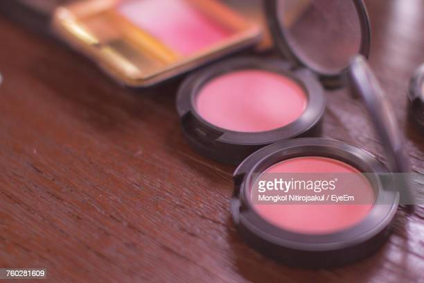close-up of powder compact on wooden table - powder compact stock pictures, royalty-free photos & images