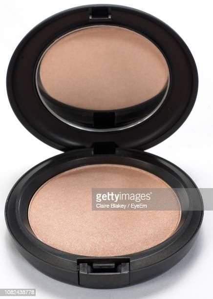 close-up of powder compact over white background - powder compact stock pictures, royalty-free photos & images